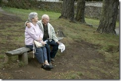 old-happy-senior-couple-sitting-on-bench
