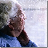 old woman looking out window